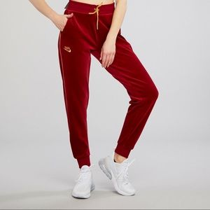 NIKE HERITAGE VELOUR SWEATPANTS